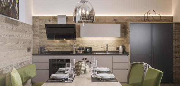 cutting-edge kitchen with large eating area at Apartment Lovely Frieda