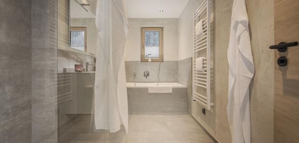 bathroom with walk-in shower and bathtub